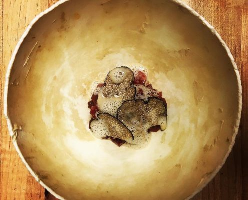 Smoked ostrich tartare served in it's shell with turnip and foie gras.
